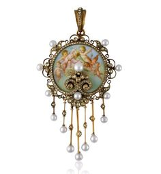 Enamel, diamond and pearl putti pendant mounted in gold, in fitted case. 19th century.