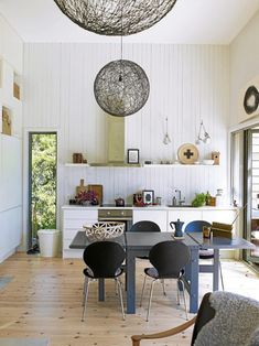 a beautiful home in norway - dining room table and light