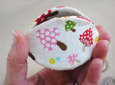 Coin purse made out of yogurt lids.