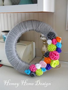 Easy wreath... minus making the flowers. And so bright and colorful. Love that it used a foam wreath.. but I saw a twig one on sale