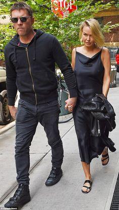 Lara Bingle and Sam Worthington seen arriving at their hotel in New York City, New York on September 20, 2014.