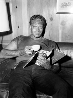 Charlton Heston in his trailer, cup of tea and Playboy mag 1959