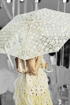 Sunshade parasol made of silk logo-detailed fabric with alligator-skin handles. Marc Jacobs for Louis Vuitton Spring 2012 runway
