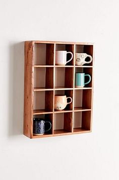 12cubby shelf made from acacia wood with a rich grain featuring compartments for mugs crystals trinkets and more. Mounts to wall. UO exclusive. Content  Care    Acacia wood    Wipe clean    Imported   Size    Dimensions 18l x 4.5w x 24h    Shelf dimensions 4.5l x 5.5h    Shelving weight limit 26 lbs    Weight 11.68 lbs Mug Storage, Kitchen Wall Storage, Entryway Storage, Kitchen Decor, Rental Kitchen, Cabinet Storage, Kitchen Organization, Diy Kitchen, Kitchen Ideas