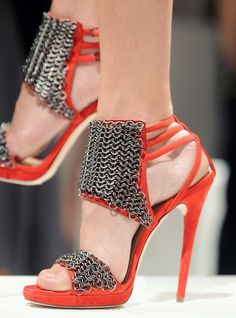 i like how the chains give these more egde, i hate a wimpy shoe! I love these you need to send me a pair quick.