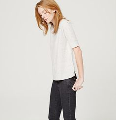 Delicately flecked - and light and drapey - we borrowed sweatshirt details to get this swingy style. Ballet neck. Short sleeves. Banded neckline. Wide ribbed cuffs. Hi-lo vented shirttail hem.
