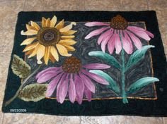 Designed and hooked by Rose Hampshire using flower templates provided by (and in a class with) Jeanne Field.