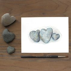 """Heart Rocks"" is an archival print based on one of my original watercolor paintings. I love rocks. I love hearts. I guess it shouldn't be a surprise that I love heart-shaped rocks. This painting is of"