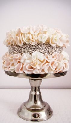 Interesting cake with a great peach texture and bright bling metallic.