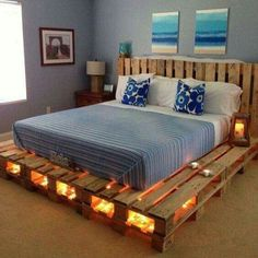 Pallet headboard and pallets with lights for the mattress base.