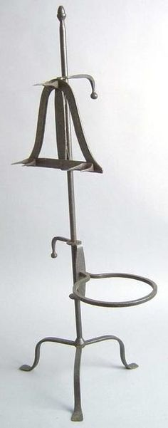 "An English wrought iron bird roaster or spit with trivet. 18th Century. H: 32""."