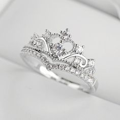 DESCRIPTION DETAILS Unique and beautiful this ring features ultra shine cubic zirconia crystals arranged in a princess crown design Ring Silver Alloy Ul. Cute Jewelry, Bridal Jewelry, Silver Jewelry, Pandora Jewelry, Silver Earrings, Cute Promise Rings, Cute Rings, Engagement Rings Princess, Princess Rings