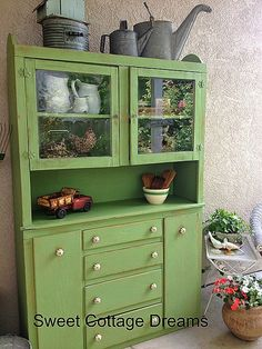 A cabinet transformation.  I used Benjamin Moore's Buckingham Garden paint.  I painted it with Ben Moore's chalk paint.  You can add any color in the line to the paint.