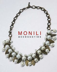 https://www.tokopedia.com/monili/kalung-mutiara-stylish-nc-037-bronze