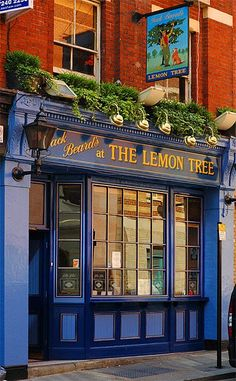 Color inspiration for kitchen!!!!  If only I could sway my hubby to the side of bold colors...    shop front Lemon Tree, London