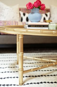 Gold spray painted bamboo table.It took a little sanding, a coat of spray primer, and the Montana Gold spray paint I told you about last week.  The color I used is called Goldchrome and it went on like a dream.