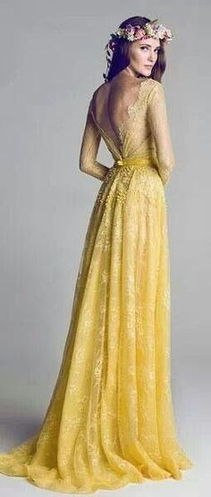 Yellow wedding gown.  This could be perfect for the right venue!  Romantic and airy lace with a vintage look. #weddingdress