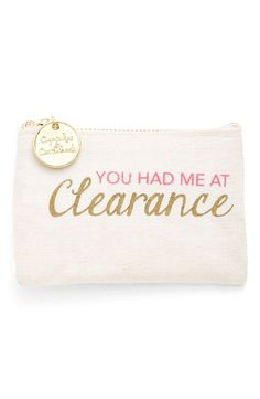 Embracing the inner bargain-hunter with a charming, sturdy coin purse stamped with a glittery 'You had me at clearance' motto and secured with a gilded logo-medallion zip pull.