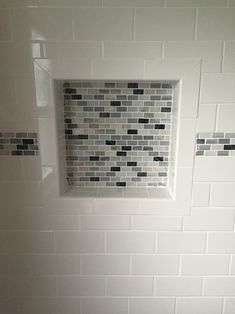 U.S. Ceramic Tile Color Collection Bright Snow White Subway Tile with DUROCK 16 in. x 16 in. x 4 in. Shower Niche, tiled with Daltile Snow Illusion 2-5/8 in. x 12 in. Ceramic Decorative Accent Wall Tile all from Home Depot.
