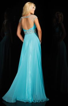 Le Gala 114541 is a classically gorgeous dress with some trendy details! The cap sleeve top is sheer and overlays a strapless style, sweetheart bust. The chiffon skirt has a swing hemline.