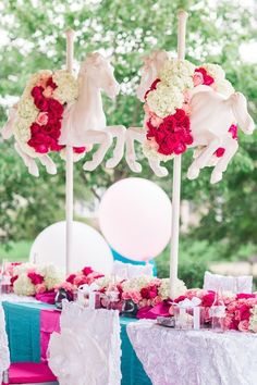 Way too cute! | Centerpiece at a Royal Carousel Birthday Party via Kara's Party Ideas