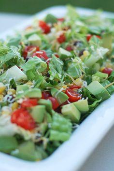 taco salad with fresh tomatoes, corn, and avocado
