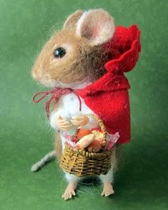 "A sweet little handmade miniature mouse pretending to be ""Little Miss Red Riding Hood'."