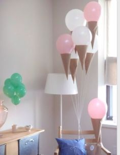 DIY Party DecorationsTape a variety of different sized balloons on the wall. Perfect for a celebration on new years!Party backdrop made with 3 dollar store disposable table cloths.   With 3 plastic table cloths, place them on on top of the other and and cut upward leaving a couple inches at the top. Then braid the strands of each table cloth together for another inch or so.Popsicle stick easels!Helium balloon and dollar tree net!Sparkle/ confetti dipped balloons!
