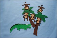 """Five Cheeky Monkeys Felt Set Pattern PDF Digital Download  Five cheeky monkeys swinging in a tree  Teasing Mister Crocodile: """"You cant catch me, You cant catch me. Along comes Mister Crocodile, Quiet as can be, And SNAPPED that monkey Right out of that tree!  Each Monkey is 10.5 cm x 10 cm ( about 4 inches) The crocodile is 25 cm x 14 cm (10 inches x 5 inches) Benefits of Felt Board Rhymes, Stories & Games   Promotes development of numeracy and literacy skills  Helps in the development of..."""