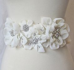 Ivory Bridal Sash by The Red Magnolia.....  I do not own this image it represents a link to a website that displays it