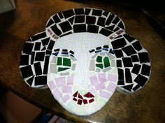 Recycled glass mosaic on found wood cutout.