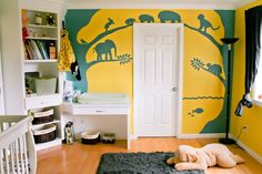 A Bright Yellow & Blue Mural of Animals at Play