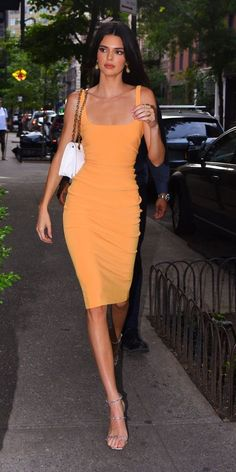 Kendall Jenner stopped by a NYC bodega in a body-hugging orange dress by Bec & B. Kendall Jenner s Mode Outfits, Fashion Outfits, Lazy Outfits, School Outfits, Prada Outfits, Tennis Outfits, Heels Outfits, Jeans Fashion, Dressy Outfits