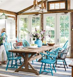 Farmhouse table, a mix of chairs, great lighting, French doors to the garden ... a perfect dining space