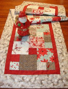 The wonderful fabrics in this collection create a wintery scene perfect for Christmas or all winter long. Icy blue, a mid-tone gray, and snowy white combine with rich red in snow covered branches, tiny red birds in the trees, poinsettia-like flowers, and an interesting geometric print in this over-sized table runner. The size is approximately 17 X 66 (43 X 168 cm) - long enough to span a dining room table or buffet, or drape over the ends of a coffee table. You could even use it on a bedroom…