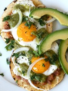 Authentic Huevos Rancheros with homemade salsa, refried beans, fried eggs, and avocado
