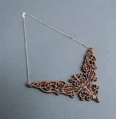 Exquisite intricate laser-cut wood necklace.    Filigree Necklace by hendersondrygoods on Etsy