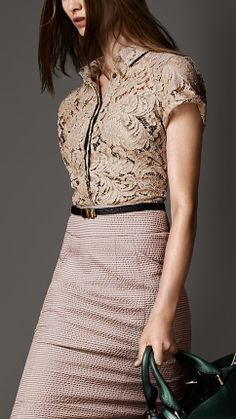 lace shirt goes well with a single color skirt