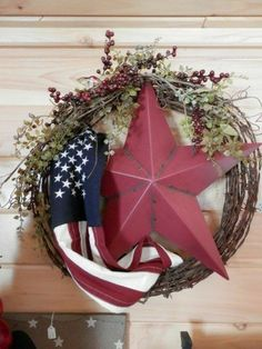 Rusty barbed wire draped with an American Flag, red star, greens and berries Patriotic Wreath, Patriotic Crafts, July Crafts, Holiday Crafts, Holiday Decor, Patriotic Party, Holiday Parties, Fourth Of July Decor, 4th Of July Decorations