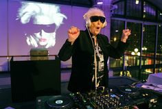 DJ Wika Szmyt plays music at a club in Warsaw. Szmyt, 73, spends her retirement days behind a DJ console watching people dance to her rhythms. She plays disco, rumba or samba for a mostly elderly audience because she feels she is giving them a new take at life.