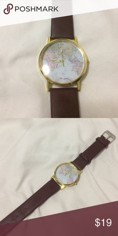 World map watch from urban outfitters this womens watch features a world map watch from urban outfitters this womens watch features a world map on on a white face it has brown faux leather straps and gold detail gumiabroncs Gallery