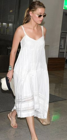 02e3788cf6 With Summers Little White Dress   Amber Heard arrived at the airport in  Japan wearing a white midi-length tank dress from Twelfth Street by Cynthia  ...