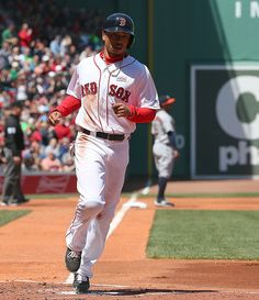 Mookie Betts of the Boston Red Sox scores in the first inning against the Houston Astros at Fenway Park on May 15 2016 in Boston Massachusetts