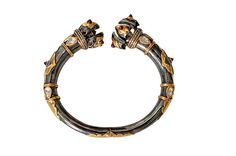"""The """"Vajra"""" open cuff from Amrapali, in ruthenium-plated silver with 18-karat gold, rubies and diamonds ($4,684)"""