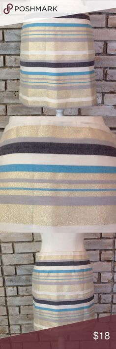 NWOT GOLD STRIPED SKIRT In mint condition. Beautiful gold sparkles striped skirt. Measures 17 inches long.  Waist measures 15 inches flat LOFT Skirts