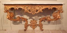 Large #console in carved #giltwood #Regency period, in the style of Bernard #Tureau said Toro. Quadrangular belt with straight moldings, crossbar enriched with acanthus leaves. The pediment is decorated with consoles and lion masks. #18th century. For sale on Proantic by Galerie Pellat de Villedon.