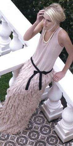 Ruffles pearls dress( has a #Gatsbyesque feel to me, probably due to drop waist and ruffles. The blush colour, black ribbon, the basic top and length add a modern flair-- love!/cm)