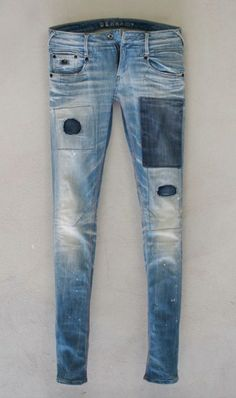 Dark denim patches on light wash skinny denim