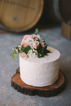 Rustic single tier buttercream wedding cake with peach flower topper | Katherine Schultz Photography