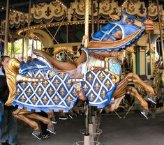 Fluer de Lis Horse Le Carrousel de Lancelot, Disneyland, Paris, France All 16 of the outer-row horses along with one spare horse were designed by American carver Joe Leonard, and were carved by Joe and four staff members. The finished horses were sent to Florida where they were painted by Disneyland artists before being shipped to France. All 17 of these hand-carved horses are armored horses.